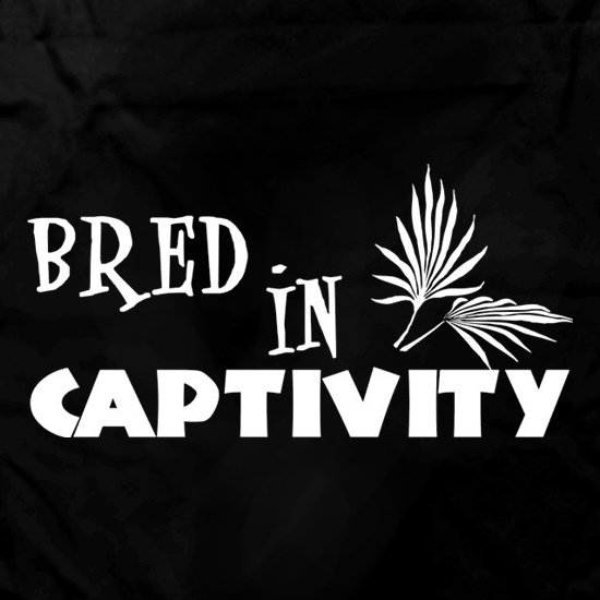 Bred In Captivity Apron